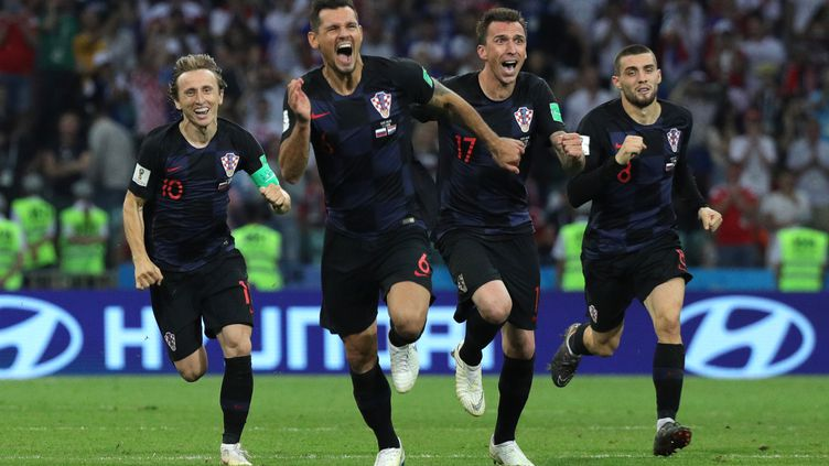 Les Croates lors de la victoire face à la Russie (CHRISTIAN CHARISIUS / DPA)