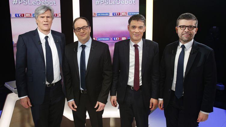 Les candidats à la primaire du Parti socialiste, Stéphane Le Foll, Emmanuel Morel, Olivier Faure et Luc Carvournas, le 7 mars 2018 à Boulogne-Billancourt (Hauts-de-Seine). (GEOFFROY VAN DER HASSELT / AFP)