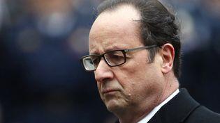 François Hollande, le 13 janvier 2015, à la préfecture de police de Paris, lors d'une cérémonie en hommage aux trois policiers tués dans les attentats. (PATRICK KOVARIK / AFP)