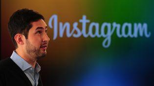 Le PDG d'Instagram, Kevin Systrom, lors d'une conférence de presse à New York, le 12 décembre 2013. (EMMANUEL DUNAND / AFP)