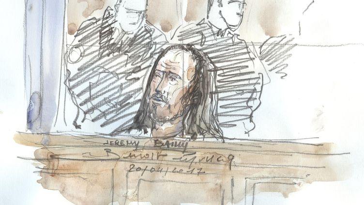 """Un membre de la cellule jihadiste """"Cannes-Torcy"""" à son procès à Paris, le 20 avril 2017. (BENOIT PEYRUCQ / AFP)"""
