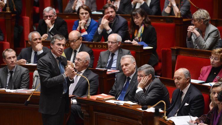 Jérôme Cahuzac devant les députés lors des questions au gouvernement, à l'Assemblée nationale à Paris, le 19 février 2013. (MIGUEL MEDINA / AFP)