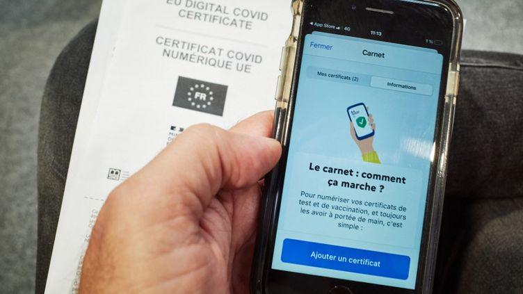 L'application TousAntiCovid, le 29 juin 2021. (MATHIEU THOMASSET / HANS LUCAS / AFP)