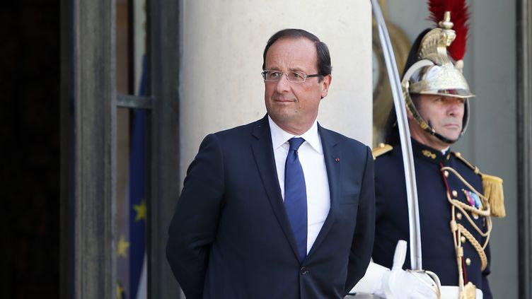 François Hollande, le 22 août 2012 à l'Elysée (Paris). (KENZO TRIBOUILLARD / AFP)