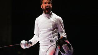 Romain Cannone en action lors de l'épreuve d'épée individuelle aux Jeux olympiques de Tokyo, le 25 juillet 2021. (MOHD RASFAN / AFP)