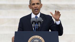 """Le président américain Barack Obama, lors de son hommage à Martin Luther King, cinquante ans après son discours historique """"I Have a Dream"""", à Washington (Etats-unis), le 28 août 2013. (SAUL LOEB / AFP)"""