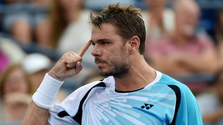 Stan Wawrinka s'est qualifié pour les quarts de finale de l'US Open 2014 (STAN HONDA / AFP)