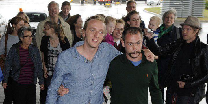 Les journalistes Martin Schibbye et Johan Persson à leur arrivée à Stockholm le 14 Septembre 2012 après leur libération. (ANDERS WIKLUND / SCANPIX-SWEDEN / AFP)
