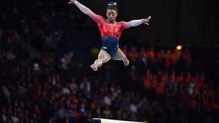 La gymnaste américaine Simone Biles, lors des mondiaux de Stuttgart (Allemagne), le 8 octobre 2019. (FRANKHOERMANN/ SVEN SIMON / DPA PICTURE-ALLIANCE / AFP)