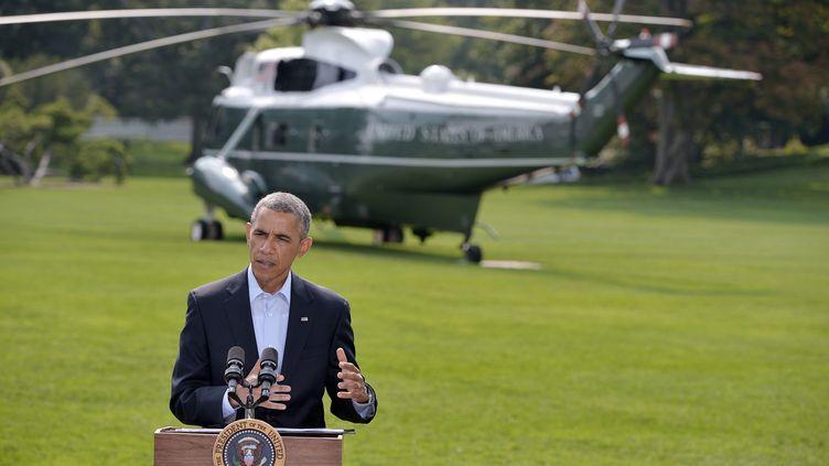 Barack Obama sur la pelouse de la Maison Blanche, à Washington, samedi 9 août 2014. (MANDEL NGAN / AFP)