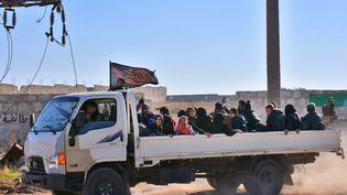 Des habitants d'Alep (Syrie) arrivent dans un camp situé dans unezone gouvernementale, le 27 novembre 2016. (GEORGE OURFALIAN / AFP)
