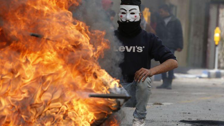 Un manifestant palestinien à Hébron (Cisjordanie), le 7 décembre 2017. (HAZEM BADER / AFP)