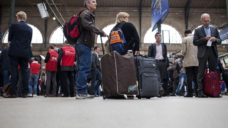 Des usagers de la SNCF à la Gare du Nord à Paris, le18 juin 2014 (FRED DUFOUR / AFP)