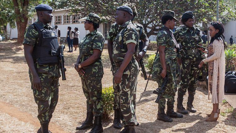 Policiers à Lilongwe, capitale du Malawi, le 26 juin 2019 (AMOS GUMULIRA / AFP)