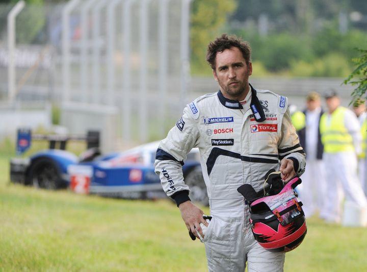 Franck Montagny quitte sa Peugeot numéro 2, le pilote français est contraint d'abandonner (JEAN-FRANCOIS MONIER / AFP)