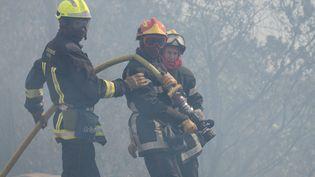 Photo d'illustration de pompiers qui luttent contre un feu. (MAXPPP)