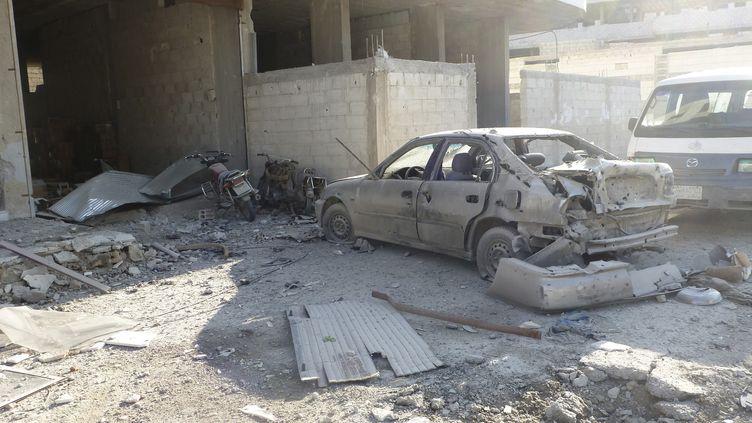 Une voiture piégée a explosé le 12 décembre 2012 à Erbeen (Syrie), près de Damas. (REUTERS)