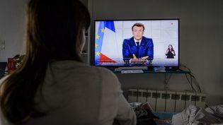 Emmanuel Macron s'adresse aux Français, pendant la pandémie de Covid-19, le 31 mars 2021. (JACOPO LANDI / HANS LUCAS / AFP)