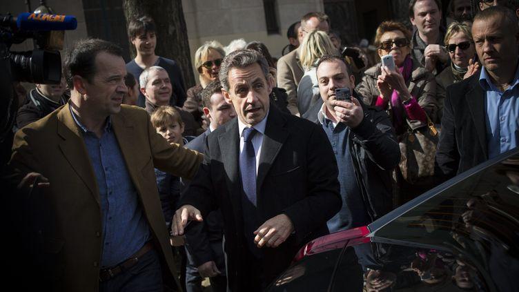 L'ancien chef de l'Etat, Nicolas Sarkozy, lors du premier tour des élections municipales, le 23 mars 2014. (MAXPPP)