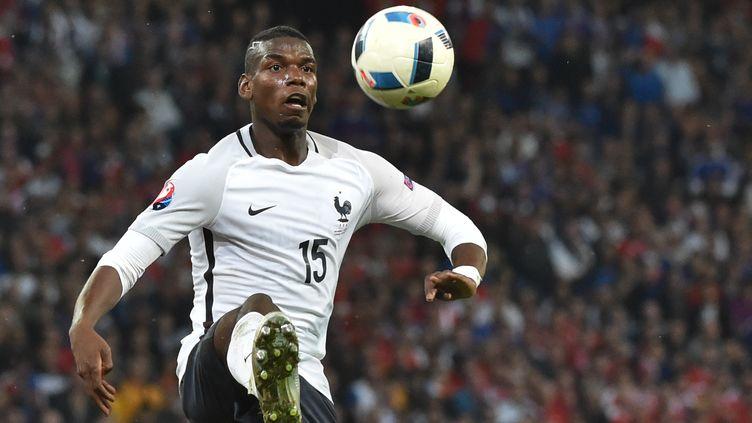 Paul Pogba (équipe de France) contre la Suisse (PHILIPPE HUGUEN / AFP)