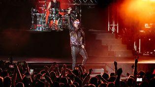 Le batteur Dominic Howard et Matt Bellamy du groupe de rock britannique Muse se produisent en concert lors de l'IndyCar Classic au Circuit of the Americas, le 23 mars 2019 à Austin, au Texas. (SUZANNE CORDEIRO / AFP)
