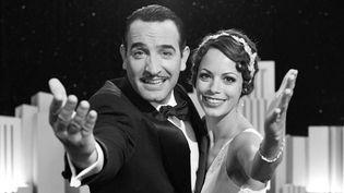 "Jean Dujardin et Bérenice Béjo dans ""The Artist"".  (© Warner Bros. France)"