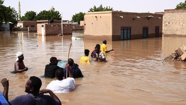 Inondation dans le village de Wad Ramli, à 50 km de Khartoum, sur la rive est du Nil. Photo prise le 26 août 2019. (EBRAHIM HAMID / AFP)