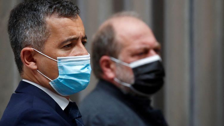 Le ministre de l'Intérieur Gérald Darmanin et le ministre de la Justice Eric Dupond-Moretti à l'Elysée, à Paris, le 28 avril 2021. (GONZALO FUENTES / AFP)