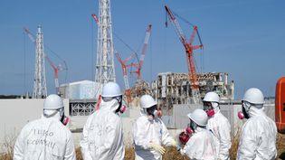 Les liquidateurs de la centrale de Fukushima (Japon) février 2012 (YOSHIKAZU TSUNO / AFP)