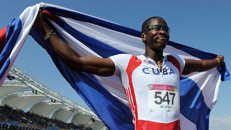 """Dayron Robles vise un temps inférieur à 13""""20 en Guadeloupe. (JUAN BARRETO / AFP)"""