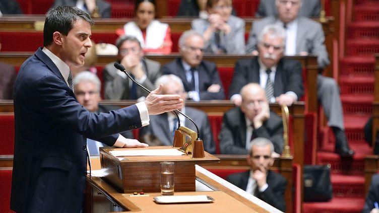 Manuel Valls, lors de son discours de politique générale devant l'Assemblée nationale, le 8 avril 2014. (ERIC FEFERBERG / AFP)