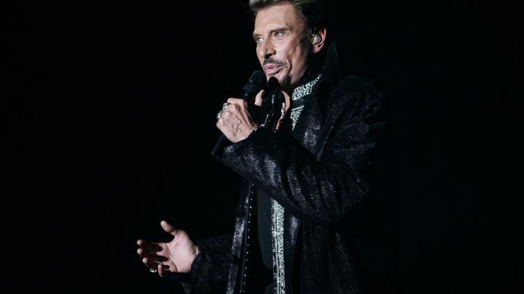 Johnny Hallyday, le 29 septembre 2006, à Paris. (FRED DUFOUR / AFP)