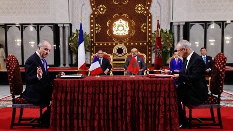 (Laurent Fabius a signé ce texte avec Ahmed Toufik, le ministre marocain des Affaires religieuses © REUTERS)