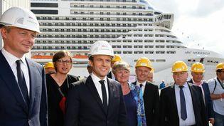 Emmanuel Macron lors de la cérémonie de livraison et changement de pavillon du paquebot MSC Meraviglia construits aux chantiers STX de l'Atlantique de Saint-Nazaire, le 31 mai 2017. (MAXPPP)