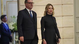 Sandrine Doucen et son compagnon Richard Ferrand, à l'Elysée, à Paris, pour un dîner avec le président sud-coréen, le 15 octobre 2018. (CHRISTOPHE PETIT-TESSON / AFP)