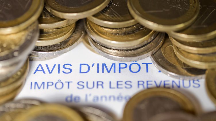 L'indexation du barème de l'impôt sur le revenu sera rétablie dès 2014, a indiqué le premier ministre Jean-Marc Ayrault, à Paris, le 27 août 2013. (JOEL SAGET / AFP)