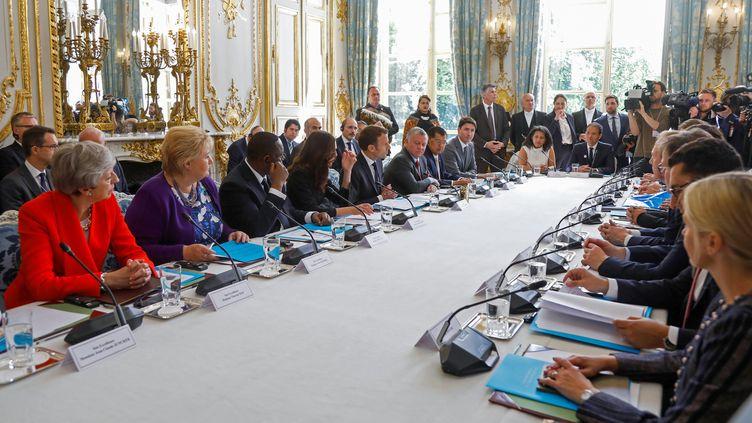 """Les chefs d'Etat signataires de """"l'appel deChristchurch"""", dont Emmanuel Macron, réunis à l'Elysée, à Paris,le 15 mai 2019. (CHARLES PLATIAU / AFP)"""