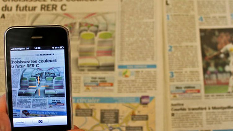 L'application iDoog qui permet de photographier les articles du Parisien (© Angel HERRERO LUCAS)