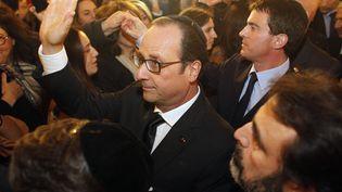 Le président, François Hollande, et le Premier ministre, Manuel Valls,arrivent à la Grande Synagogue de Paris pour une cérémonie de deuil, le 11 janvier 2015. (MATTHIEU ALEXANDRE / POOL)