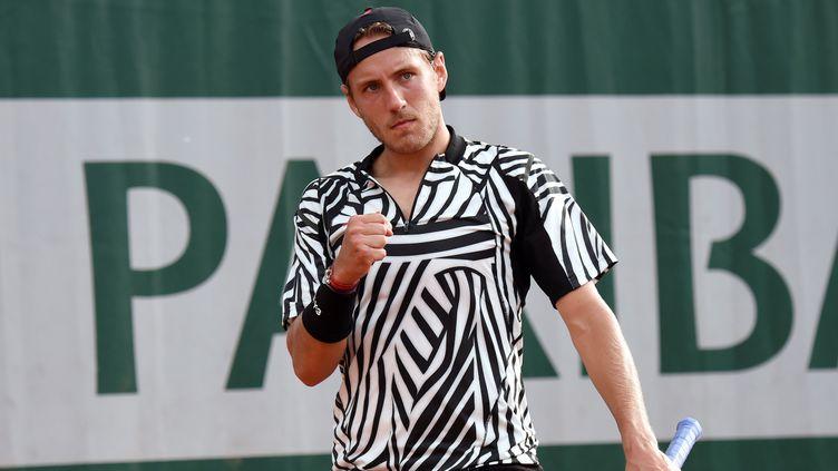 (Lucas Pouille au tournoi de Roland Garros 2016 © AFP/ ERIC FEFERBERG)