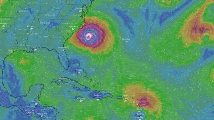 Capture écran du site Windy représenatnt l'évolution des ouragans Florence et Isaac, le jeudi 13 septembre 2018. (FRANCEINFO)