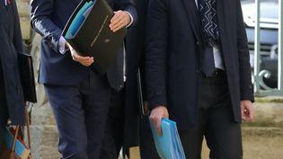 Edouard Philippe, alors Premier ministre, et Olivier Dussopt, ministre des Comptes publics, le 7 novembre 2018 à Charleville-Mézières (Ardennes) (LUDOVIC MARIN / AFP)