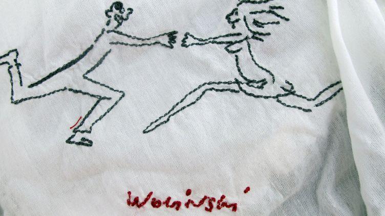 Un dessin de Wolinski reproduit sur des bas pour femmes.  (Nina B�rschneider/dpa/picture-alliance/MaxPPP)