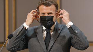 Emmanuel Macron à l'Elysée (Paris), le 1er mai 2021. (LUDOVIC MARIN / POOL / AFP)