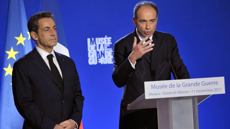 Nicolas Sarkozy et Jean-François Copé font tribune commune, à Meaux (Seine-et-Marne), le 11 novembre 2011. (PHILIPPE WOJAZER / POOL)