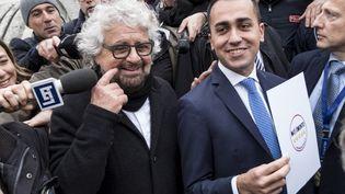 Beppe Grillo (à g.), fondateur du Mouvement 5 étoiles, et Luigi Di Maio, leader du parti, le 4 mars 2018. (ANDREAS SOLARO / AFP)