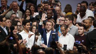 Le ministre de l'Economie, Emmanuel Macron, lors du premier meeting de son mouvement En marche !, le 12 juillet 2016 à la Maison de la Mutualité à Paris. (BENOIT TESSIER / REUTERS)