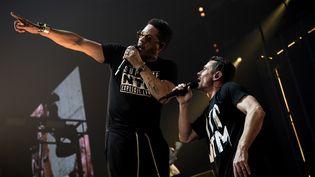 Joey Starr et Kool Shen se produisent sur la scène de l'AccorHotels Arena, le 8 mars 2018, à Paris. (CHRISTOPHE ARCHAMBAULT / AFP)