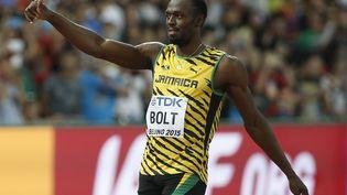 Le Jamaïcain Usain Bolt lors des Mondiaux d'athlétisme de Pékin (Chine), le 22 aout 2015. (ADRIAN DENNIS / AFP)