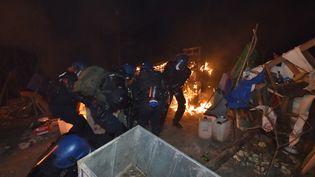 Des gendarmes dans le bois Lejuc, sur une photo diffusée par la gendarmerie nationale, le 22 février 2018 à Bure (Meuse). (GENDARMERIE NATIONALE / AFP)